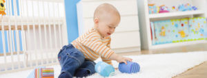 healthy baby playing